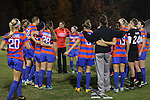 22 November 2013: Florida head coach Becky Burleigh (in orange) and her players huddle before the game. The University of Florida Gators played the Duke University Blue Devils at Koskinen Stadium in Durham, NC in a 2013 NCAA Division I Women's Soccer Tournament Second Round match. Duke won the game 1-0.