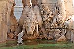 Lion in the 17th century Fiumi Fountain in the Piazza Navona