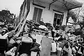 New Orleans, Louisiana.USA.February 19, 2006..A man in the 7th ward collects items that others have thrown out for the flooding after hurricane Katrina.