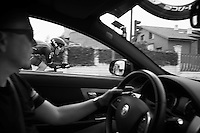 Geraint Thomas (GBR/SKY) flashes by Carsten Jeppesen's car who's following Ian Boswell (USA/SKY) who started 2 minutes earlier<br /> <br /> stage 17: Burgos-Burgos TT (38.7km)<br /> 2015 Vuelta &agrave; Espana