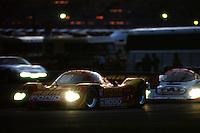 DAYTONA BEACH, FL - JANUARY 31: The MOMO Nissan NPT-90 of Gianpiero Moretti, Derek Bell, Massimo Sigala, John Paul Jr. and François Migault leads a group of cars during the 24 Hours of Daytona IMSA GT race at the Daytona International Speedway in Daytona Beach, Florida, on January 31, 1993.
