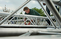 NWA Democrat-Gazette/BEN GOFF @NWABENGOFF<br /> Robert Moore with Bentonville Parks and Recreation helps assemble the finish line structure Friday, June 8, 2018, for the Memorial Park Glow Run. The two-mile run starting at 8:45 p.m. kicks off the Bentonville Parks and Recreation 2018-19 Run Bentonville Race Series. Participants receiver glow-in-the-dark race shirts, Energizer headlamps and other 'glow gear' for the after dark race.