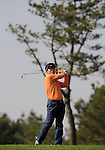 JEJU, SOUTH KOREA - APRIL 23: Y.E. Yang of Korea plays his second shot on the 4th hole during the Round Two of the Ballantine's Championship at Pinx Golf Club on April 23, 2010 in Jeju island, South Korea. Photo by Victor Fraile / The Power of Sport Images