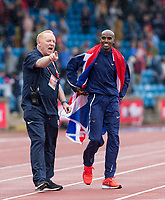 Mo Farah is guided into position for Photographers by a media team assistant during the Muller Grand Prix Birmingham Athletics at Alexandra Stadium, Birmingham, England on 20 August 2017. Photo by Andy Rowland.