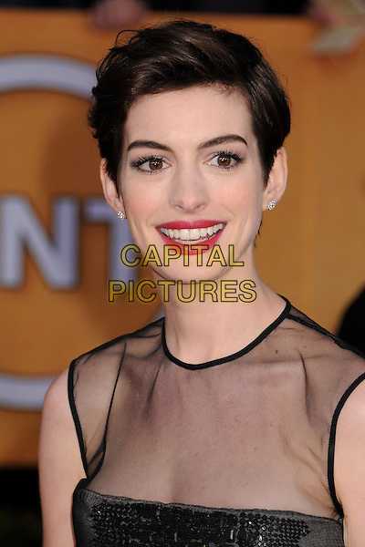 Anne Hathaway.Arrivals at the 19th Annual Screen Actors Guild Awards at the Shrine Auditorium in Los Angeles, California, USA..27th January 2013.SAG SAGs headshot portrait black sheer red pink lipstick sleeveless .CAP/ADM/BP.©Byron Purvis/AdMedia/Capital Pictures