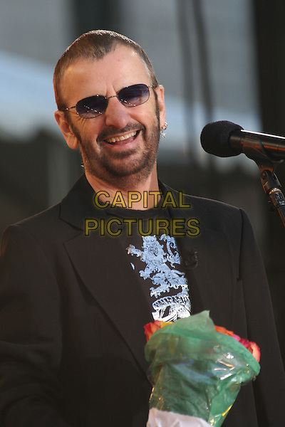 RINGO STARR.Ringo Starr & The Roundheads Perform on the Good Morning America Summer Concert Series,.Bryant Park, New York City, NY, USA,.17 June 2005..half length stage concert music gig live beard sunglasses  bunch of flowers.Ref: IW.www.capitalpictures.com.sales@capitalpictures.com.©Ian Wilson/Capital Pictures.