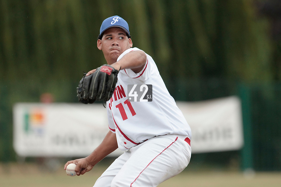 14 July 2010: Gabriel Connor of Team Saint Martin pitches during day 2 of the Open de Rouen, an international tournament with Team France, Team Saint Martin, Team All Star Elite, at Stade Pierre Rolland, in Rouen, France.