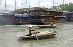 Halong-Vietnam, Ha Long - Viet Nam - 22 July 2005---Rowing boats as small cargo units and cruisers, at Halong Bay, a UNESCO World Natural Heritage Site---tourism, traffic, transport, people---Photo: Horst Wagner/eup-images