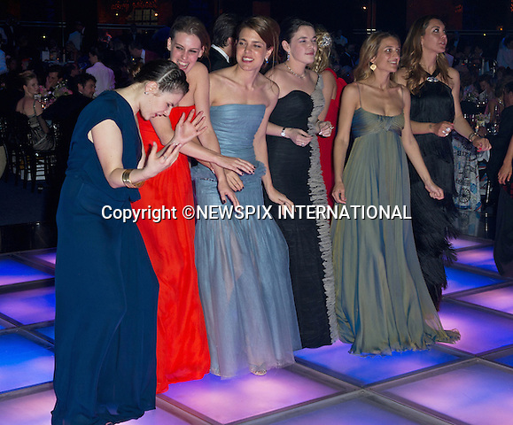 "CHARLOTTE CASIRAGHI.and friends takes to the dance floor at the Bal de la Rose..The theme for this year's Ball that raise funds for the Princess Grace Foundation was ""Swinging London""_Monte Carlo, 24/03/2012.Mandatory Credit Photos: SBM/Newspix International..**ALL FEES PAYABLE TO: ""NEWSPIX INTERNATIONAL""**..PHOTO CREDIT MANDATORY!!: NEWSPIX INTERNATIONAL(Failure to credit will incur a surcharge of 100% of reproduction fees)..IMMEDIATE CONFIRMATION OF USAGE REQUIRED:.Newspix International, 31 Chinnery Hill, Bishop's Stortford, ENGLAND CM23 3PS.Tel:+441279 324672  ; Fax: +441279656877.Mobile:  0777568 1153.e-mail: info@newspixinternational.co.uk"