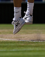 England, London, 28.06.2014. Tennis, Wimbledon, AELTC, tennis shoes on gras during service<br /> Photo: Tennisimages/Henk Koster