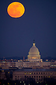 The full Moon and the U.S. Capitol are seen early in the evening on Tuesday, Feb. 7, 2012 from Arlington National Cemetery in Arlington, Virginia. .Mandatory Credit: Bill Ingalls / NASA via CNP