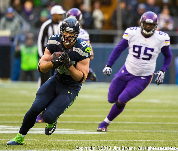 Seattle Seahawks tight end Zach Miller runs after catching a pass against the  Minnesota Vikings in the quarter at CenturyLink Field in Seattle, Washington on  November 17, 2013.  The Seahawks beat the Vikings 41-20.  ©2013.  Jim Bryant. All Rights Reserved.
