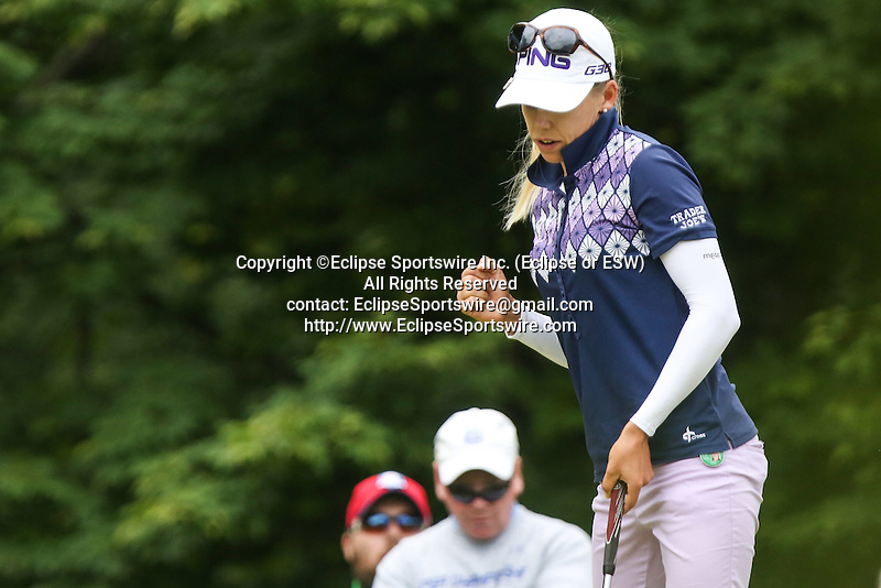 Pernilla Lindberg fist pumps after sinking her putt on the 7th green at the LPGA Championship 2014 Sponsored By Wegmans at Monroe Golf Club in Pittsford, New York on August 16, 2014