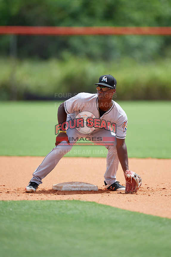 GCL Marlins shortstop Osiris Johnson (9) warms up before a game against the GCL Mets on August 3, 2018 at St. Lucie Sports Complex in Port St. Lucie, Florida.  GCL Mets defeated GCL Marlins 3-2.  (Mike Janes/Four Seam Images)