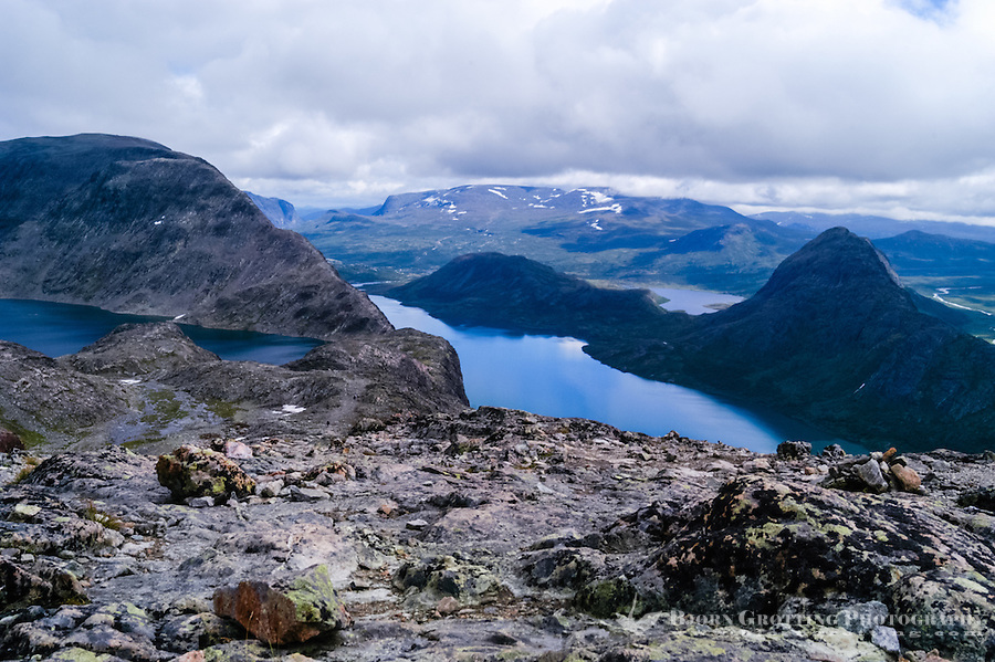 Norway, Jotunheimen. Hiking the famous Besseggen mountain ridge on the northern side of the Gjende Lake. Bessvatnet Lake to the left.