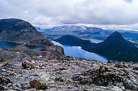Norway, Jotunheimen. Hiking the famous Besseggen mountain ridge on the northern side of the Gjende Lake. Bessvatnet Lake to the left.