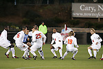 11 December 2009: Virginia's starts race away from their pregame huddle. The University of Virginia Cavaliers defeated the Wake Forest University Demon Deacons 2-1 after overtime at WakeMed Soccer Stadium in Cary, North Carolina in an NCAA Division I Men's College Cup Semifinal game.