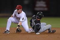 Apr 13, 2007; Phoenix, AZ, USA; Colorado Rockies second baseman (7) Kazuo Matsui beats the tag of Arizona Diamondbacks shortstop (6) Stephen Drew to steal second base in the second inning at Chase Field in Phoenix, AZ. Mandatory Credit: Mark J. Rebilas