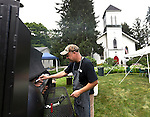 Roxbury, CT- 18 July 2015-071815CM01-  Todd Snowden of Litchfield, checks on barbecue during the annual family barbecue at Christ Church in Roxbury on Saturday. Snowden smoked up chicken and ribs and served them with baked beans and cole slaw for the attendees.  Proceeds from the event will go towards the church.    Christopher Massa Republican-American