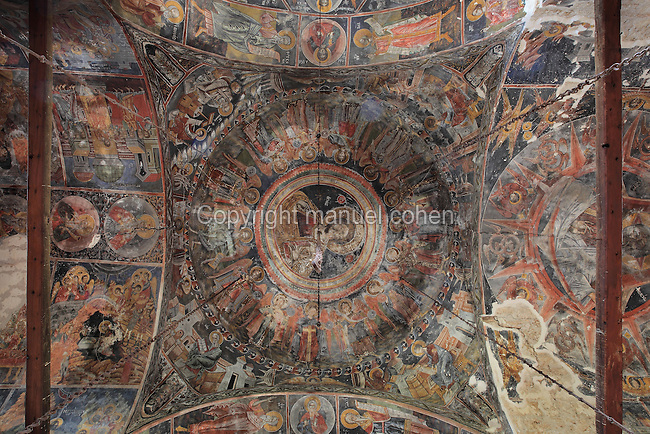 Frescoes on walls and inside ceiling dome, with Christ at the centre, 1722, by an unknown artist, in the Church of the Archangels Michael and Gabriel or Kisha e Shen Mehillit or Shen Mehilli, built 1696 and part of a larger church complex, Voskopoje, Korce, Albania. Only the naos and narthex of the church remain, although it was originally a basilica type building covered with vaults and cupolas. Picture by Manuel Cohen