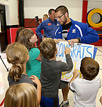 BROOKINGS, SD - SEPTEMBER 23:  South Dakota State University's Zach Zenner receives posters from students from Hillcrest Elementary made for him. Zenner was named to the 2014 Allstate AFCA Good Works Team Tuesday afternoon at Hillcrest Elementary School in Brookings. (Photo/Dave Eggen/Inertia)