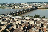 The Pont de Pierre over the Garonne river and surrounding city, Bordeaux, Gironde, France.