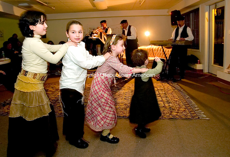 LITCHFIELD, CT- 30 DECEMBER 2006-123006JS04-Children line up as they dance to the music of The Klezmen during the ninth annual 'Klezmer on the Hills' held Saturday at the Liorah Greenberg Jewish Center in Litchfield. The Jewish celebration was organized by the Chabad Lubavitch of The Northwest Corner. <br /> Jim Shannon/Republican-American
