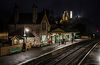 BNPS.co.uk (01202 558833)<br /> Pic: PhilYeomans/BNPS<br />  <br /> Lights, camera,...traction.<br /> <br /> Looking like a film set from a period drama - the porters and station master at Corfe Castle station wait for the last steam train from Swanage yesterday.<br /> <br /> The National Trust illuminate the historic castle over the festive period giving a timeless feel to the picturesque Dorset village.