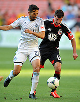 Chris Pontius (13) of D.C. United goes against Jun Marques Davidson (27) of the Vancouver Whitecaps FC. The Vancouver Whitecaps FC defeated D.C. United 1-0, at RFK Stadium, Saturday June 29 , 2013.