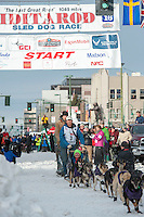 Jessie Royer and team leave the ceremonial start line with an Iditarider at 4th Avenue and D Street in downtown Anchorage, Alaska on Saturday, March 5th during the 2016 Iditarod race. Photo by Joshua Borough/SchultzPhoto.com