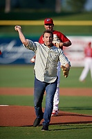 Actor Dwier Brown throws out the ceremonial first pitch before a Florida State League game between the Charlotte Stone Crabs and Clearwater Threshers on May 17, 2019 at Spectrum Field in Clearwater, Florida.  Starting pitcher Julian Garcia looks on.  Charlotte defeated Clearwater 12-4.  (Mike Janes/Four Seam Images)