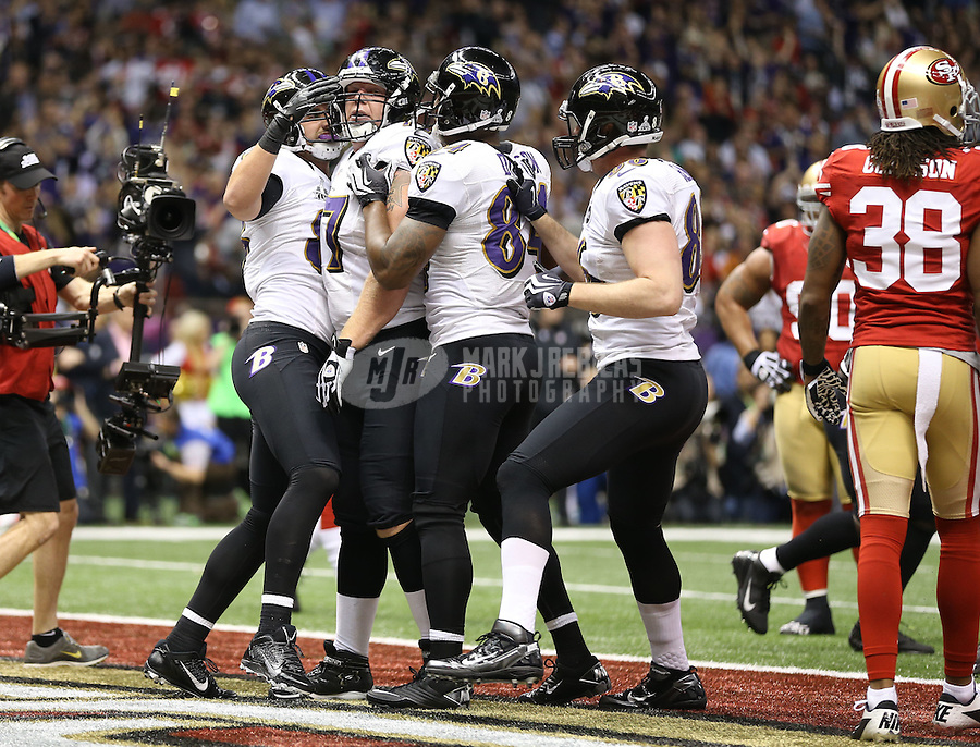 Feb 3, 2013; New Orleans, LA, USA; Baltimore Ravens tight end Dennis Pitta (left) celebrates with teammates after catching a touchdown pass against the San Francisco 49ers in the second quarter in Super Bowl XLVII at the Mercedes-Benz Superdome. Mandatory Credit: Mark J. Rebilas-
