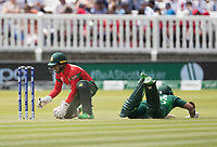 Mushfiqur Rahim (Bangladesh) collects as Imam-ul-Haq (Pakistan) dives into his ground during Pakistan vs Bangladesh, ICC World Cup Cricket at Lord's Cricket Ground on 5th July 2019