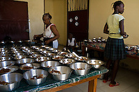 Haitian cooks preparing food in Saint Claire, the food distribution center run by a Christian organization in Port-au-Prince, Haiti, July 8, 2008.