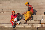 Children with cobra at ghat steps on river Ganges, Varanasi, Uttar Pradesh, India