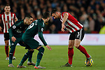 Enda Stevens (r) of Sheffield United flicks the ball away from Javi Manquillo and Miguel Almiron of Newcastle United during the Premier League match at Bramall Lane, Sheffield. Picture date: 5th December 2019. Picture credit should read: James Wilson/Sportimage
