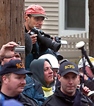 """Newsday Photographer Michael Ach on the site of the """"Extreme Makeover: Home Edition"""" TV program's rebuilding of the home of John Vitale and his family at 15 Grove Ave in St. James on Wednesday March 23, 2005. (Newsday Photo / Jim Peppler)."""