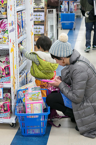 A customer shops for toys on Black Friday at a Toys''R''Us and Babies''R''Us retail store in Sunshine City commercial complex in Ikebukuro on November 25, 2016, Tokyo, Japan. Black Friday deals have only started coming to Japan in recent years and the store has discounts of up to 83% on some products up until November 27. (Photo by Rodrigo Reyes Marin/AFLO)
