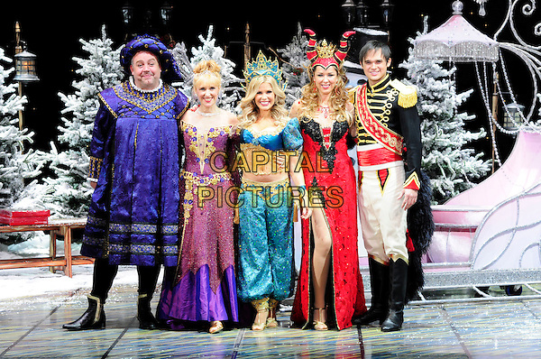 CAST - Cliff Perisai, Anita Dobson,Melinda Messenger, Claire Sweeney & Gareth Gates.First Family Entertainment theatre company's annual group Pantomime photocall at Piccadilly Theatre, London, England..November 26th, 2010.stage costume panto pantomime full length blue dress black red purple genie dress crown king queen.CAP/CAS.©Bob Cass/Capital Pictures.