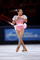 Mao Asada of Japan turns an axle on way to winning gold in ladies figure skating at the Trophee Eric Bompard competition in Paris, France, November 19, 2005.  Asada is just 15 years old and although she will not compete at the Torino 2006 Olympics, she is considered to be one of the best in the world and a bright new star in Japanese women's figure skating.  (Photo/Tom Theobald)