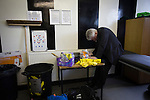An official filling in the official team lines in the away dressing room at Borough Briggs, home to Elgin City, on the day they played SPFL2 newcomers Edinburgh City. Elgin City were a former Highland League club who were elected to the Scottish League in 2000, whereas Edinburgh City became the first club to gain promotion to the League by winning the Lowland League title and subsequent play-off matches in 2015-16. This match, Edinburgh City's first away Scottish League match since 1949, ended in a 3-0 defeat, watched by a crowd of 610.