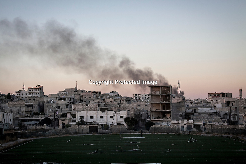In this Wednesday, Oct. 09, 2013 photo, smoke rises after a mortar shell hit a civilian area behind the frontline during heavy fighting in Maraat Al-Nouman in the Idlib province countryside of Syria. (AP/Photo)