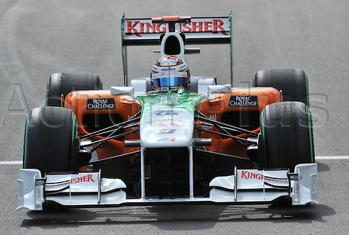 German driver Adrian Sutil of Force India drives his car across the race track during qualifying at Spa-Francorchamps Circuit near Spa, Belgium