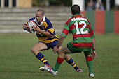 B. Maloney looks to run around his opposite P. Baird. Counties Manukau Premier Club Rugby, Waiuku vs Patumahoe played at Rugby Park, Waiuku on the 8th of April 2006. Waiuku won 18 - 15