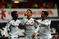 FAO SPORTS PICTURE DESK<br /> Pictured: Andrea Orlandi of Swansea (C) celebrating his goal with team mates Scott Sinclair (L) and Danny Graham (R). Saturday, 28 April 2012<br /> Re: Premier League football, Swansea City FC v Wolverhampton Wanderers at the Liberty Stadium, south Wales.