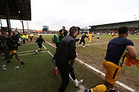 The Newport bench runs onto the pitch to celebrate successfully securing safety during the Sky Bet League Two match between Newport County and Notts County at Rodney Parade, Newport, Wales, UK. Saturday 06 May 2017