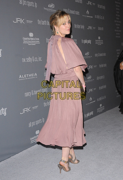 MELISSA GEORGE .Attends The 4th Annual Pink Party held at Santa Monica Airport Hanger 8 in Santa Monica, California, USA, .September 13th 2008.                                                                 .full length mauve grey gold emerald earrings dress brown snakeskin clutch bag grey gray patent sandals shoes looking back behind over shoulder .CAP/DVS.©Debbie VanStory/Capital Pictures