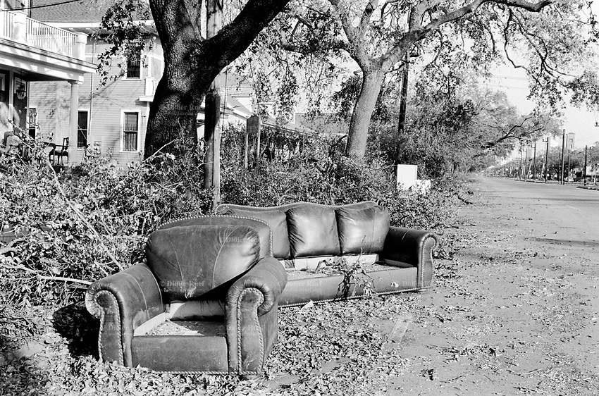 USA. Louisiana. New Orleans. Orleans Parish. Canal Street. Aftermath of hurricane Katrina. No cars and no traffic on the road. The houses (villas, detached or personal houses) were all flooded and the inhabitants have left the town. The belongings have been destroyed by the flooding water and have to be thrown away, like the leather sofa. Household refuses. Natural (boughs of trees) and urban  waste. © 2005 Didier Ruef