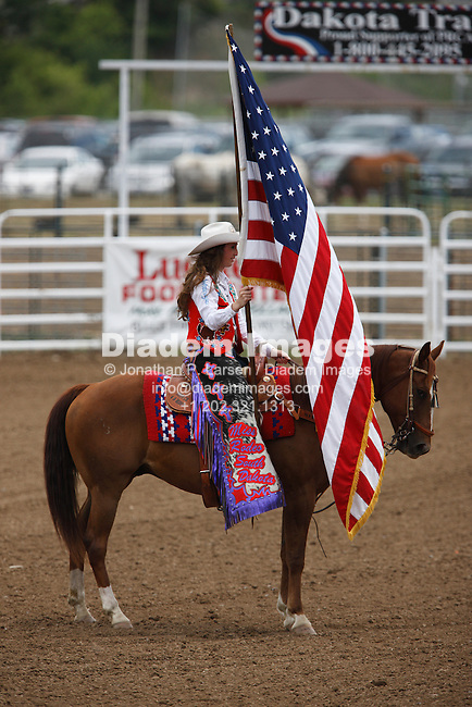 BELLE FOURCHE, SOUTH DAKOTA - JULY 4:  Courtney Smith, Miss Rodeo South Dakota, presents the American flag prior to the start of the 90th annual Black Hills Roundup rodeo in Belle Fourche, South Dakota July 4, 2009.  (Photograph by Jonathan P. Larsen)
