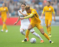Preston North End's Callum Robinson under pressure from Swansea City's Bersant Celina<br /> <br /> Photographer Kevin Barnes/CameraSport<br /> <br /> The EFL Sky Bet Championship - Swansea City v Preston North End - Saturday August 11th 2018 - Liberty Stadium - Swansea<br /> <br /> World Copyright &copy; 2018 CameraSport. All rights reserved. 43 Linden Ave. Countesthorpe. Leicester. England. LE8 5PG - Tel: +44 (0) 116 277 4147 - admin@camerasport.com - www.camerasport.com
